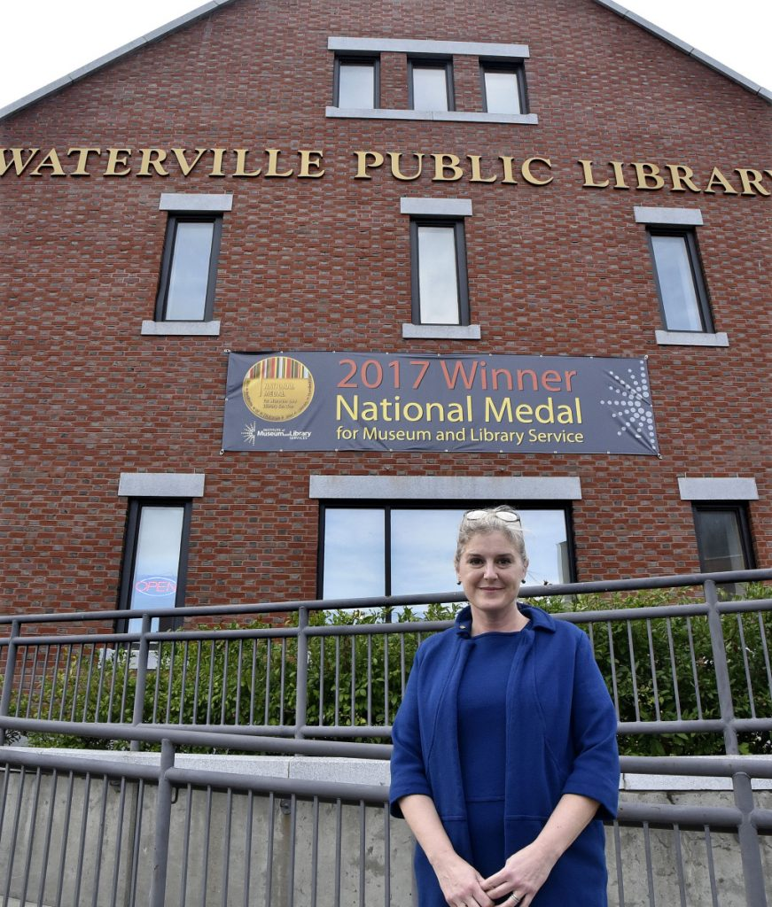 Sarah Sugden, director of the Waterville Public Library for nearly 14 years, stands outside the library Wednesday after announcing that she has accepted a position with the Brown County Library System in Green Bay, Wis.