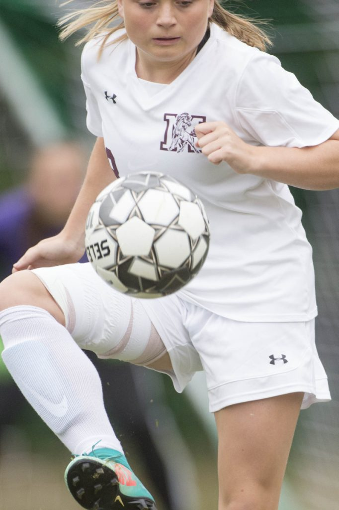Monmouth's Alicen Burnham gains control of the ball during a game against Carrabec earlier this season in North Anson.