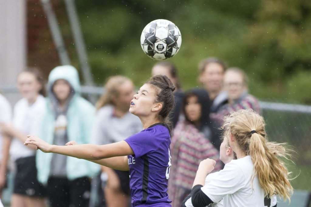 Waterville's Paige St. Pierre gets her head on the ball during a Kennebec Valley Athletic Conference game against Maranacook on Tuesday at Webber Field in Waterville.