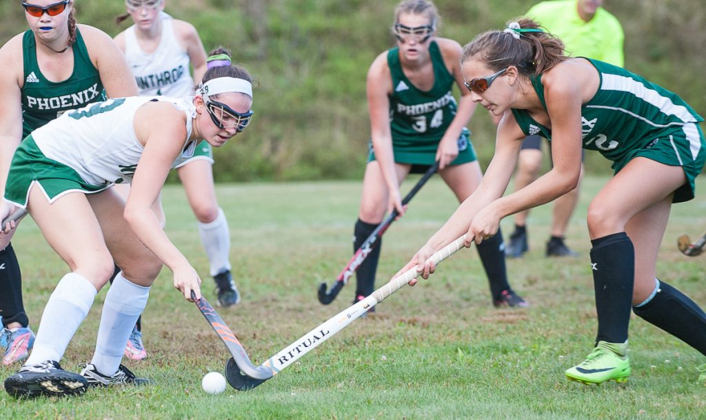 Winthrop's Gia Frances, left and Spruce Mountain's Auri Armandi battle for a loose ball during Wednesday's field hockey game in Winthrop.