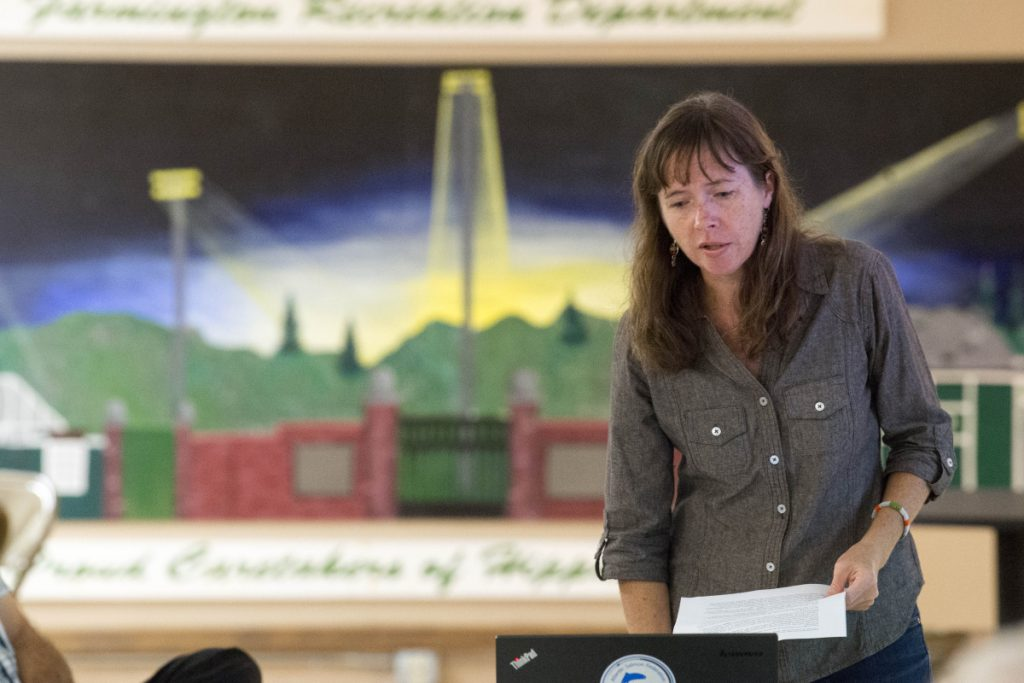 Catherine Schmitt, communications director at Maine Sea Grant, gives a presentation Wednesday at the Farmington Community Center on the proposed removal of Walton's Mill Pond Dam in Farmington.