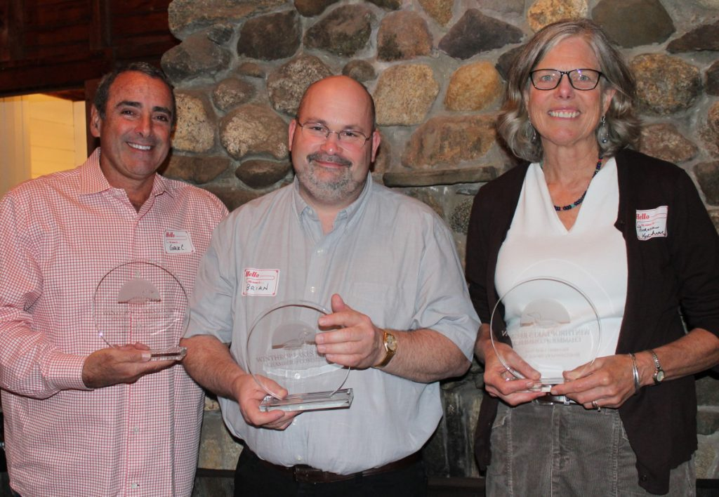"The Winthrop Lakes Region Chamber recently honored three of its members for their service to the community and its customers. From left to right: Gene Carbona, owner of The Barn at Silver Oaks Estate. Gene and his wife Veronica Carbona received the Entrepreneur Award for transforming an old Winthrop barn into one of the country's premier wedding and event destinations. Brian Ketchen, who owns Dave's Appliance, Inc. with his brothers, Mike and Scott, received the Dynasty Award for providing extraordinary customer service since 1970. Theresa Kerchner, director of Kennebec Land Trust, and her organization received the Public Service Award for their dedication to preserve land for public use and recreation in Central Maine. For more information, contact the chamber at 377-8020 or <a href=""mailto:info%40winthropchamber.org?subject="">info@winthropchamber.org</a>."