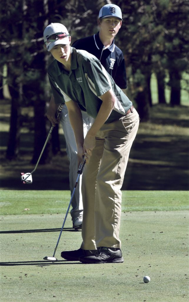 Staff photo by David Leaming   Winthrop's Zach Pray watches his put during the Mountain Valley Conference championships Thursday at Natanis Golf Course in Vassalboro.