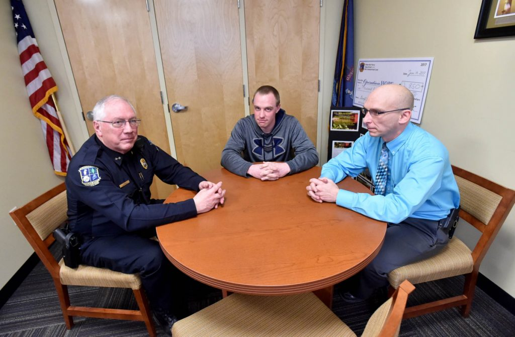 Joe Massey, Waterville's police chief, left, talks with Chase Fabian, Project Hope coordinator, center, and Deputy Chief Bill Bonney about the area's opioid troubles at the Waterville Police Department on Feb. 21, 2017. Bonney plans to embark on a 10-week course for law enforcement executives on Monday at the FBI National Academy in Quantico, Virginia.