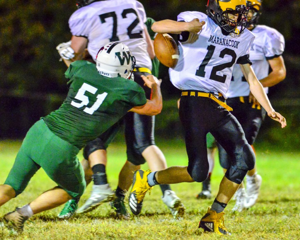 Winthrop/Monmouth/Hall-Dale linebacker Keegan Gruver, left, knocks the ball loose as Maranacook's Hunter Glowa runs with it during a game Friday at Maxwell Field in Winthrop. Maranacook recovered the fumble and even made a first down on the play.