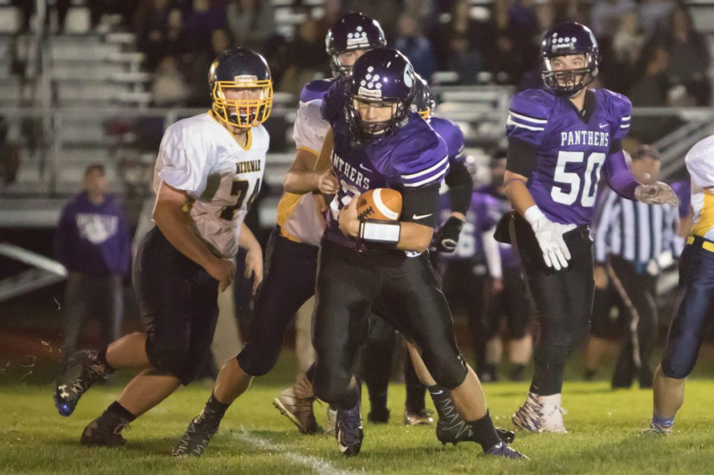 Waterville quarterback Jack Thompson carries the ball in a game against Medomak Valley on Friday night in Waterville.