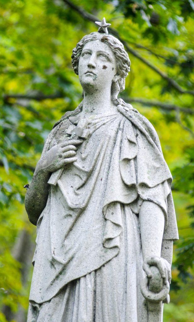 A detail shot of statue shown Friday in the Maine Avenue Cemetery in Farmingdale.