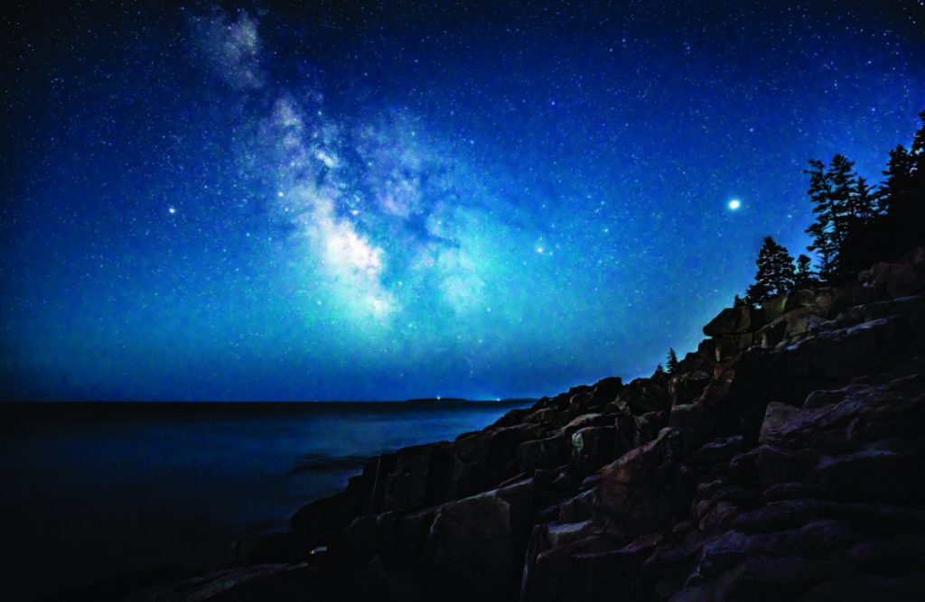 The Milky Way glimmers above the ocean off the coast of Acadia National Park early on the morning of April 23.