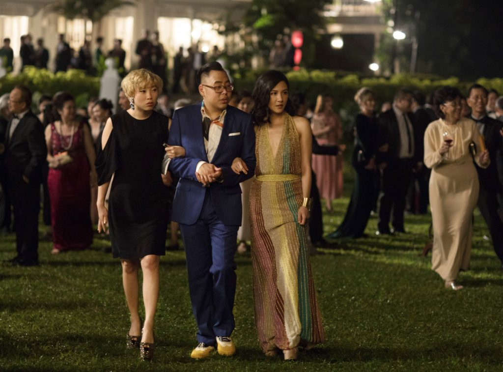 """Awkwafina, left, Nico Santos and Constance Wu in a scene from """"Crazy Rich Asians."""""""