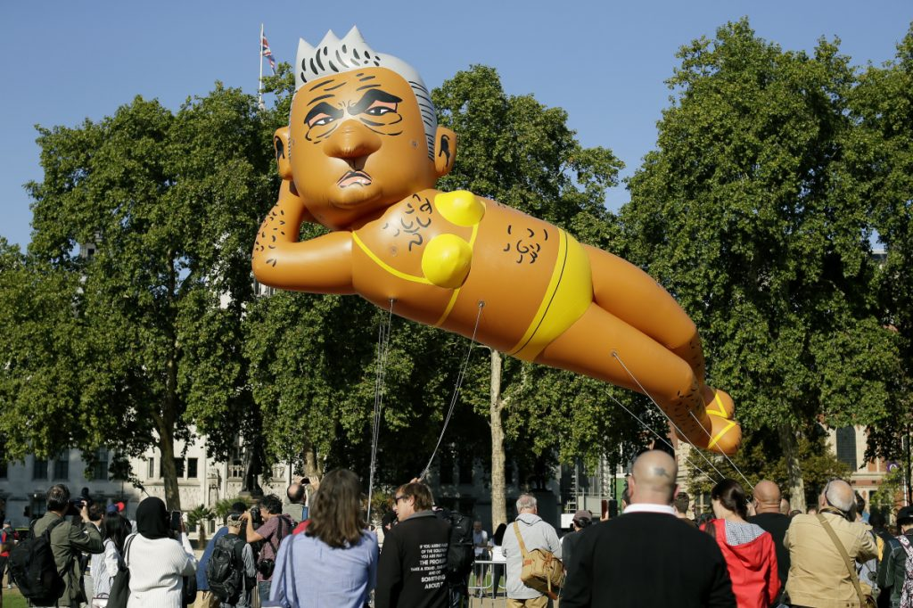 An inflatable caricature balloon of Mayor of London Sadiq Khan is released over Parliament Square in London on Saturday.