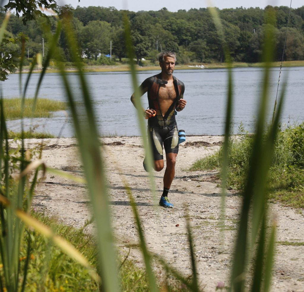 John Stevens, who will compete Monday in the swimrun world championship endurance race, has been training on Little Diamond Island – part of a Casco Bay he knows intimately.