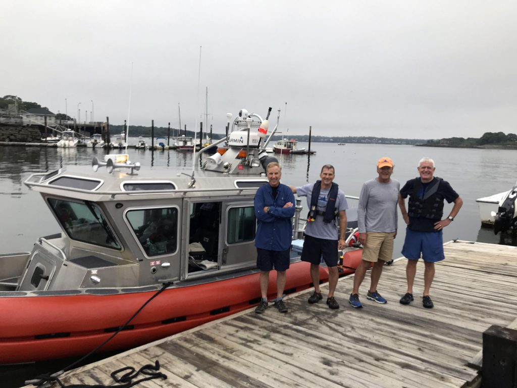 Ford Reiche, second from right, proposed taking his 25-foot former Coast Guard response boat on an unprecedented sprint from Kittery to Lubec, and did so on Aug. 13. With him are, from left, Tux Turkel, Doug Welch and Mark Fasold.