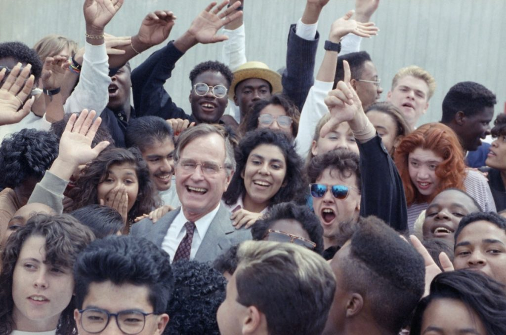 In 1990, President George H.W. Bush joins students from a Los Angeles program that assists youths who have been in foster care or on probation.