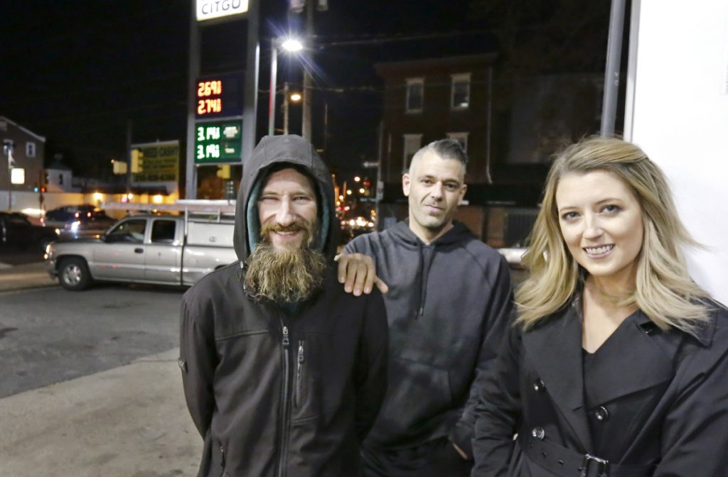 Johnny Bobbitt Jr., left, Kate McClure and McClure's boyfriend, Mark D'Amico, in 2017.  McClure and D'Amico raised more than $400,000 for Bobbitt, a homeless man, after he used his last $20 to fill her gas tank when she was stranded with no money.