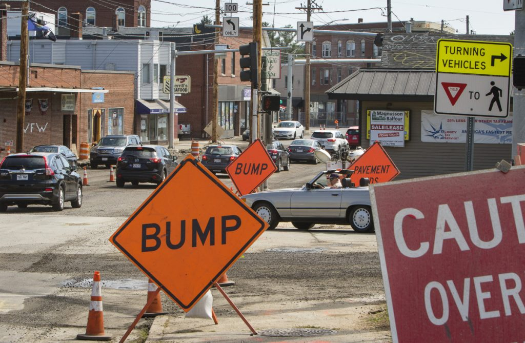 Motorists navigate road construction at Woodfords Corner in Portland recently. This weekend, work at railroad crossings will shut down a stretch of Forest Avenue, rerouting traffic onto Stevens Avenue just as Deering Center holds its annual Porchfest celebration.