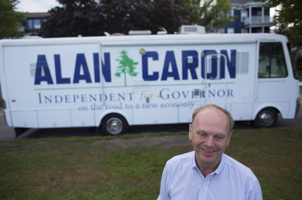 Independent Alan Caron stands Thursday in front of his new campaign vehicle, a 32-foot RV, at the Eastern Promenade in Portland, the final stop on a trip begun in Fort Kent.