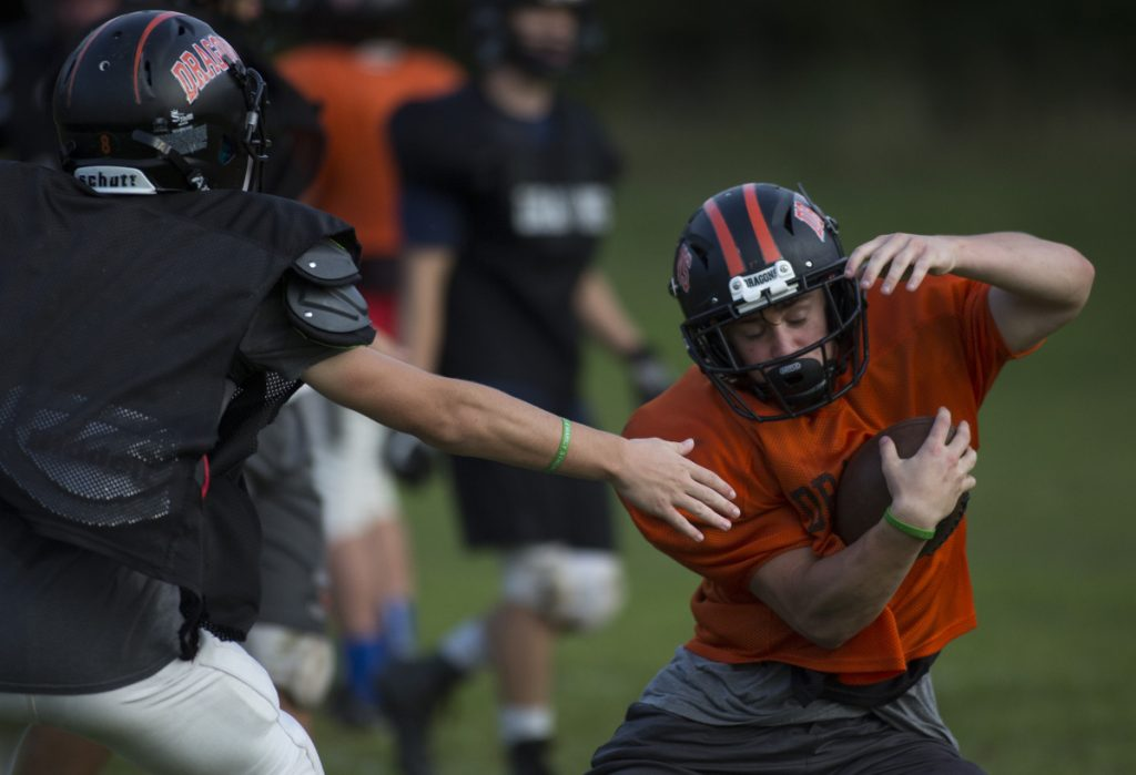 Brunswick junior running back Owen Richardson, shown eluding a tackle at a preseason practice, broke his collarbone in the season opener against Falmouth and will miss six-to-eight weeks. (Staff photo by Brianna Soukup/Staff Photographer)