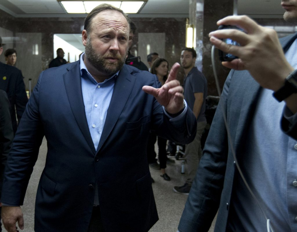 "Alex Jones, the right-wing conspiracy theorist, walks the corridors of Capitol Hill on Wednesday after listening to Facebook COO Sheryl Sandberg and Twitter CEO Jack Dorsey testify before the Senate Intelligence Committee on ""Foreign Influence Operations and Their Use of Social Media Platforms."""