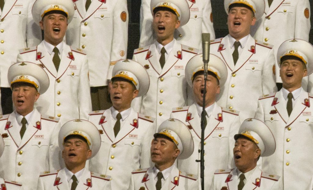 North Korea's military choir sings Saturday on the eve of the 70th anniversary of the country's founding day in Pyongyang.
