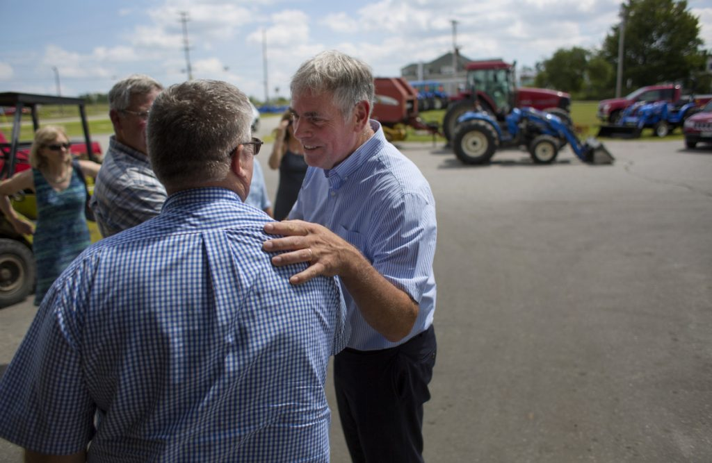 On the campaign trail, Republican gubernatorial candidate Shawn Moody of Gorham interacts last month with Rodney Ingraham, owner of Ingraham Equipment in Knox. Not long after joining the party, Moody crushed three experienced rivals in the GOP primary last June.