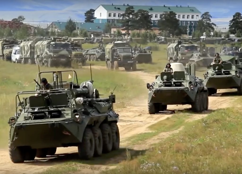 Armored personnel carriers roll out during the Vostok 2018 military exercises in Russia on Tuesday. Nearly 300,000 Russian troops and 36,000 tanks are expected to participate.