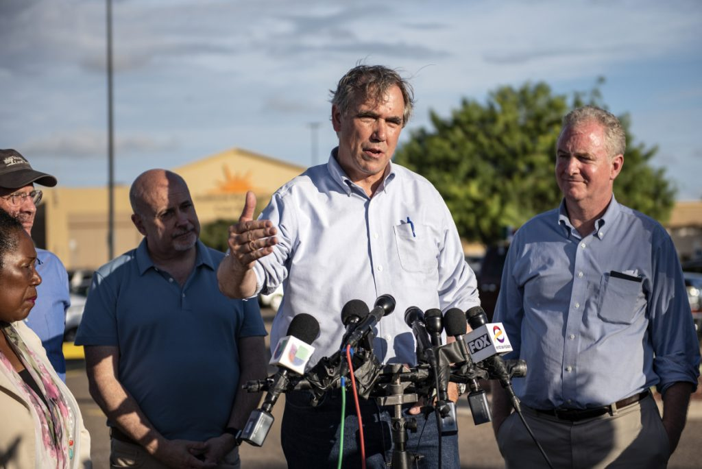 Sen. Jeff Merkley, D-Ore., second from right, speaks to members of the media outside of the Southwest Key-Casa Padre Facility, in Brownsville, Texas in June.