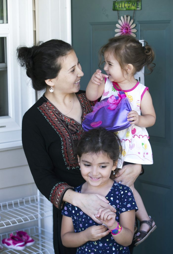 Safiya Wazir and her daughters Aaliyah and Mahwash are shown outside their home in Concord, N.H., in August.