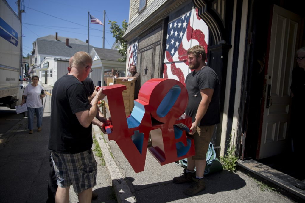 "Gavan Soule, right, and Bruce Gamage, left, remove a ""LOVE"" sculpture from Robert Indiana's home in July. Indiana's artwork was removed so it could be assessed and appraised. The work was supervised by James Brannan, the attorney who is representing the late artist's estate."