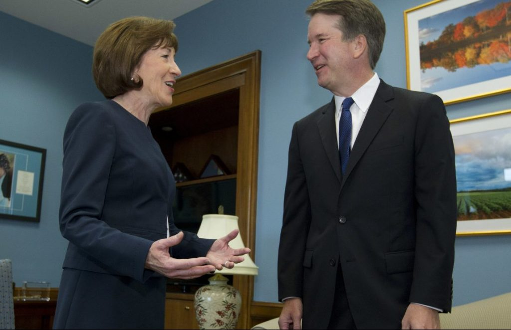 Sen. Susan Collins speaks with Supreme Court nominee Judge Brett Kavanaugh at her office before a private meeting in August. As a rare potential swing vote in the Senate, she is the focus of an intense lobbying effort.