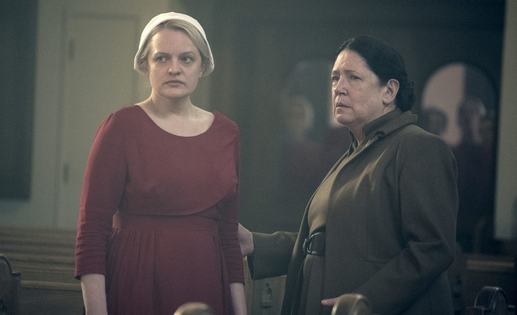 "Elisabeth Moss, left, and Ann Dowd in ""The Handmaid's Tale."" The Hulu series is favored to win the best drama award in Monday's Emmy Awards."