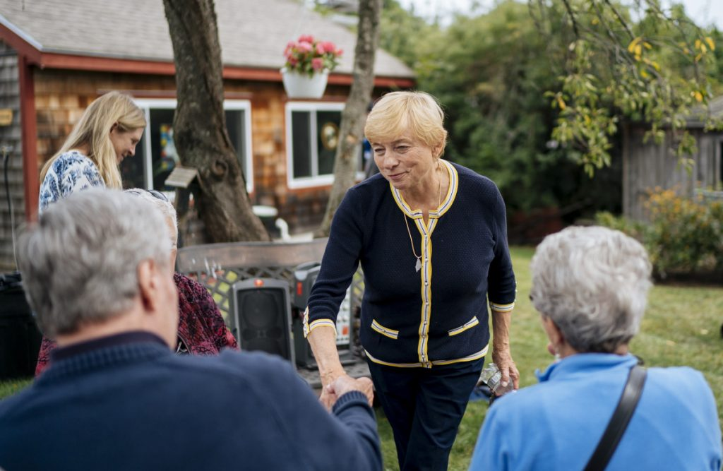 """Democratic candidate for governor Janet Mills, the state's attorney general, greets supporters at the South Portland home of State Rep. Lois Reckitt on Sept. 8. Described by her brother Peter as """"an incredible fighter,"""" she defeated six opponents to win her party's nomination in June."""