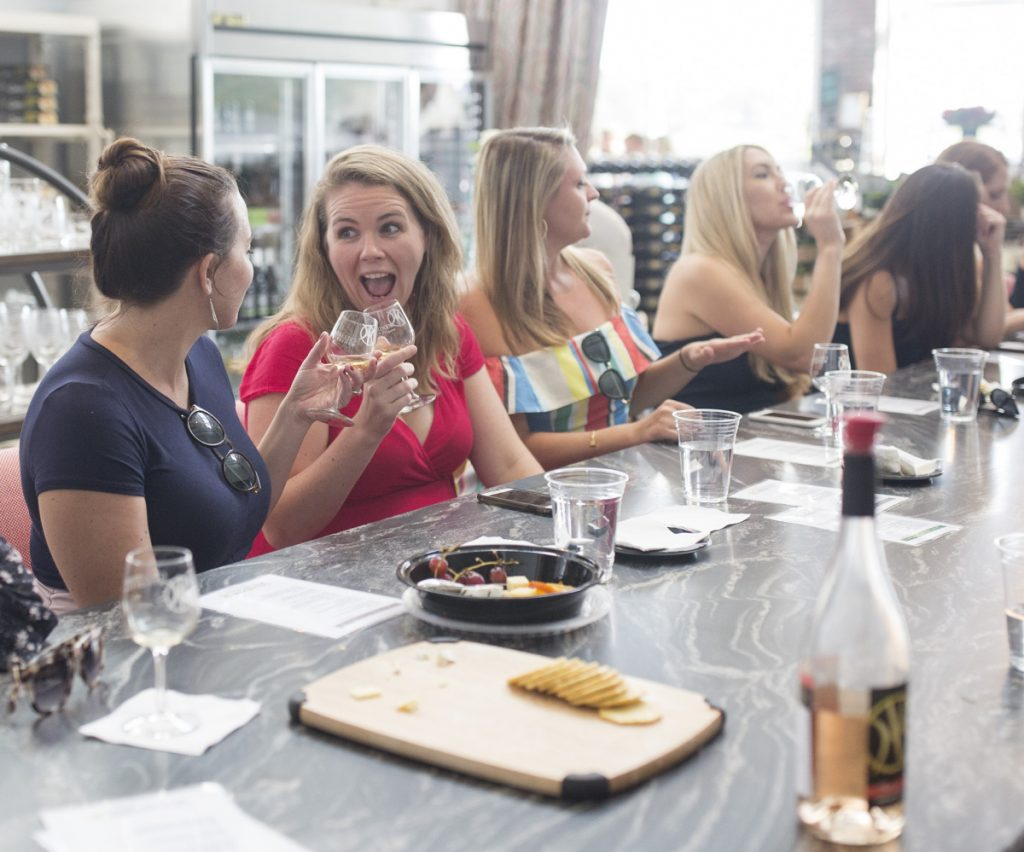 Bride-to-be Katie Dooley, left, clinks a glass with her friend Brittany Walsh at Cellardoor Winery during a bachelorette party weekend in Portland recently. Cellardoor welcomes not only the business from party-of-12 tasting events like these, but also the social-media buzz it generates.