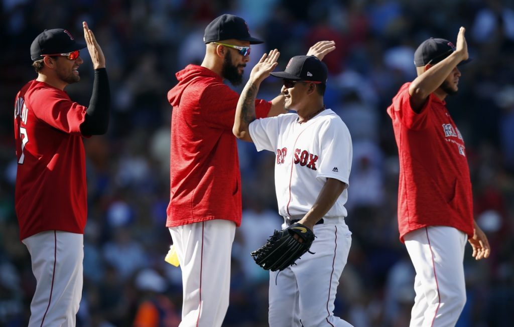 Boston Red Sox's Tzu-Wei Lin, center right, celebrates with pitchers, from left, Nathan Eovaldi, David Price and Eduardo Rodriguez after a 4-3 win Sunday against the New York Mets.