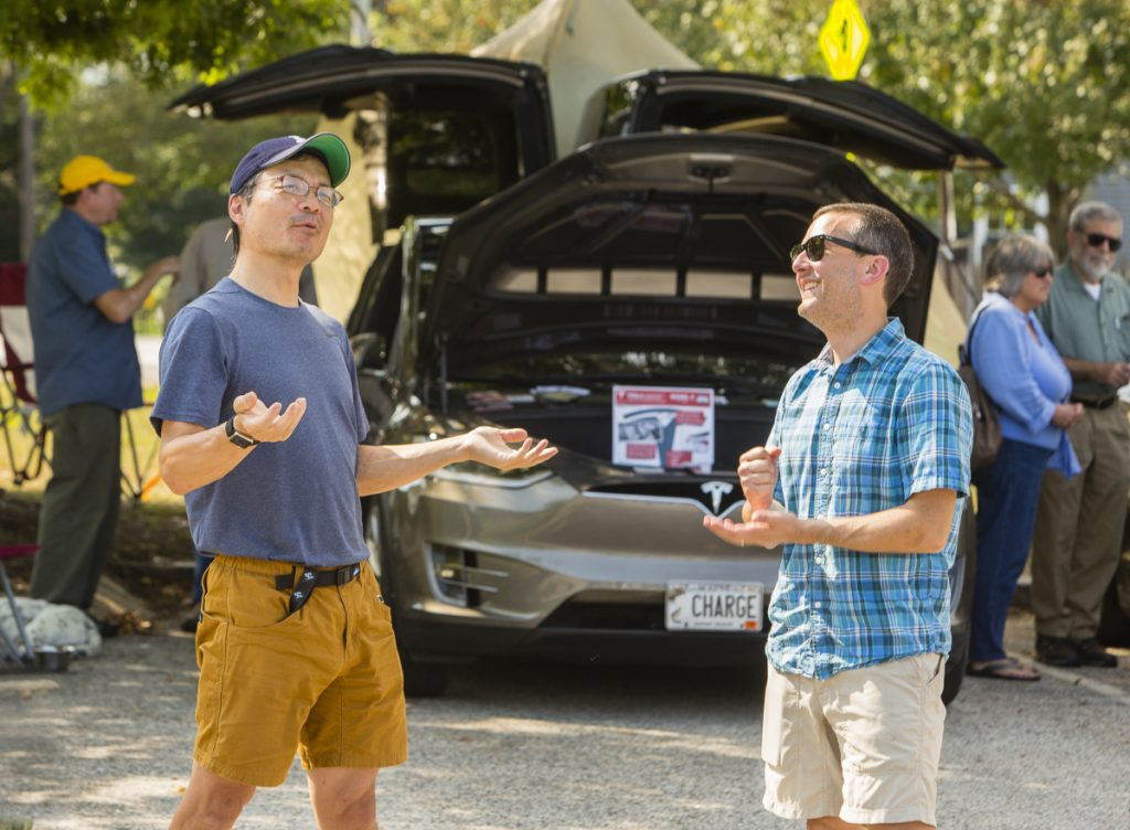 Ken Chang Of West Gardiner Left Talks Electric Cars With Mike Stivaletti South Portland During An Car Event At The Community