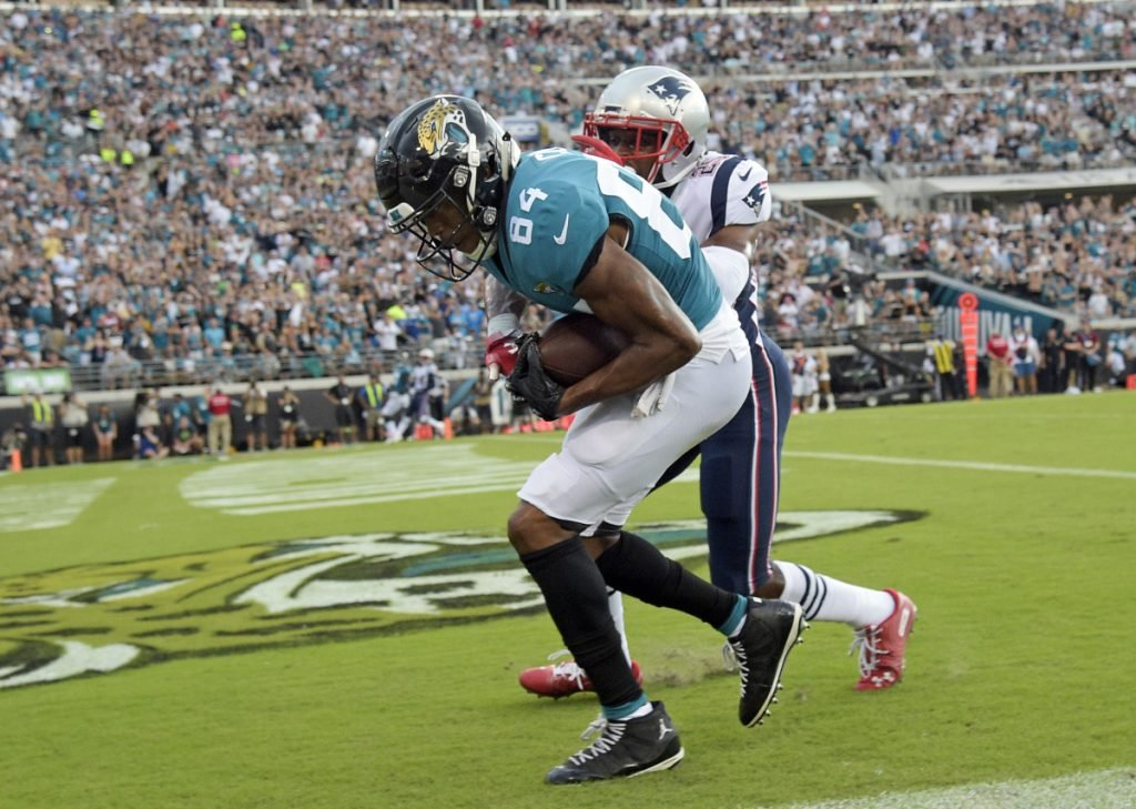 Jaguars wide receiver Keelan Cole catches a pass for a 24-yard touchdown in front of Patriots cornerback Eric Rowe in the first half Sunday in Jacksonville, Fla. Jacksonville won, 31-20.