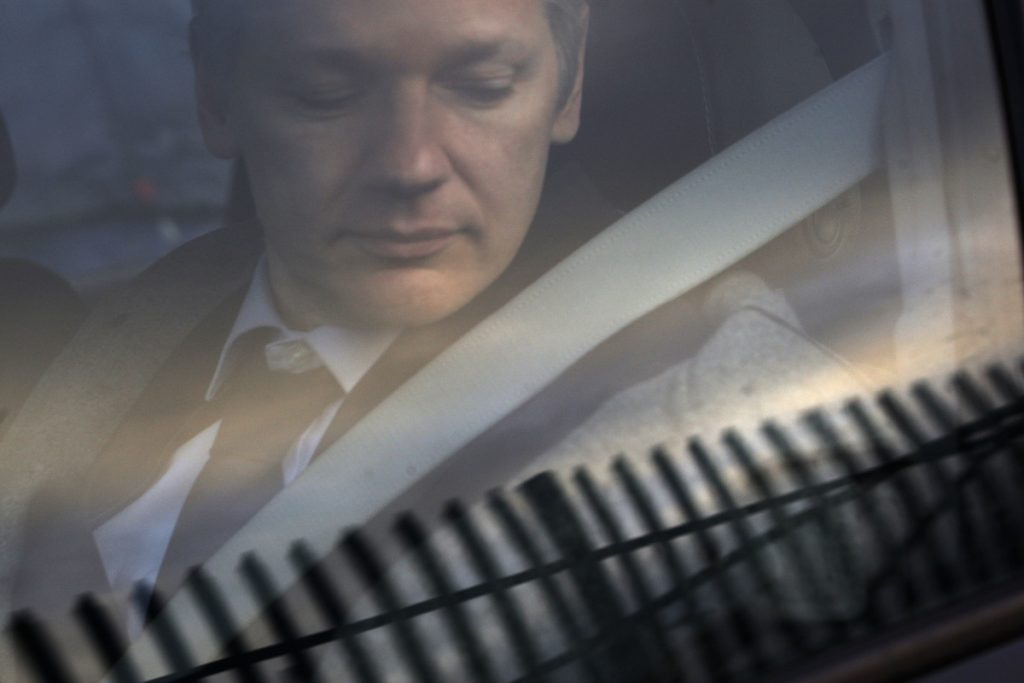 WikiLeaks founder Julian Assange arrives at Belmarsh Magistrate's court in London for an extradition hearing in 2011. According to a cache of internal WikiLeaks files obtained by the AP, Assange sought a Russian visa and staffers at his radical transparency group discussed having him skip bail and escape Britain as authorities closed in on him in late 2010.