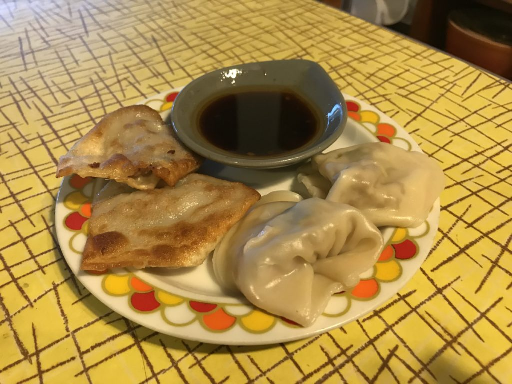 The Pork and Ginger Dumplings, a reference to Amy Tan's 'The Kitchen God's Wife,' can be boiled or pan-fried and are paired best with a sweet vinegar sauce for dipping.