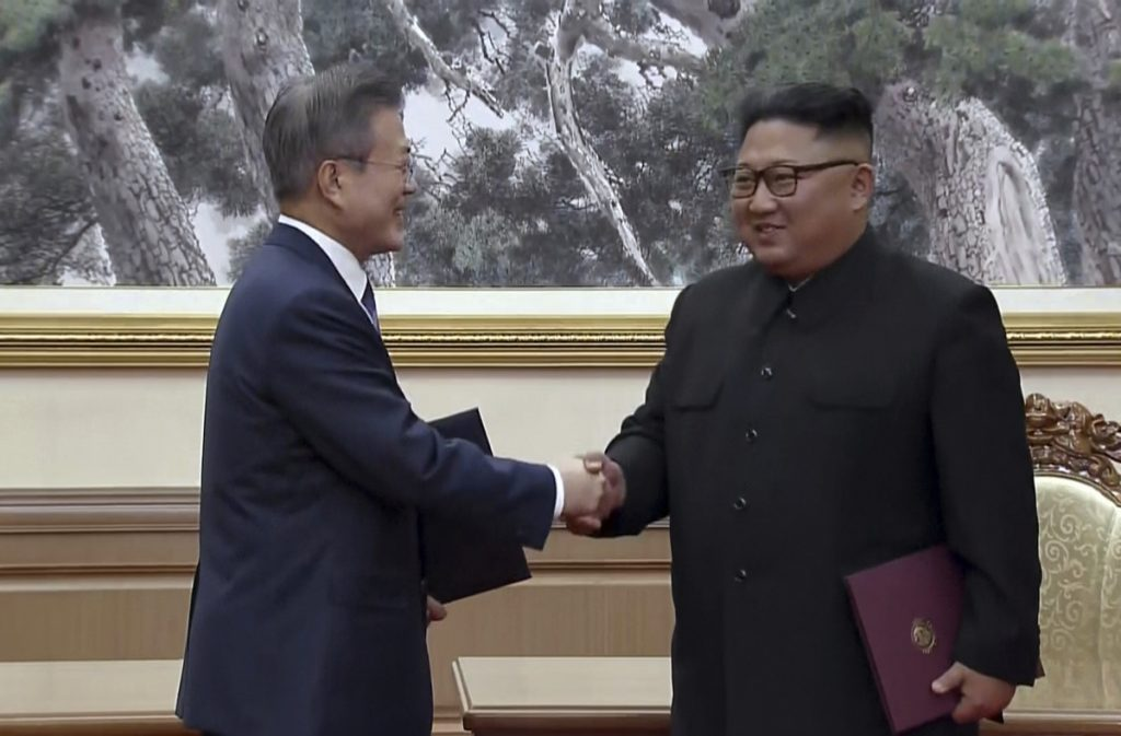 In this image made from video provided by Korea Broadcasting System, South Korean President Moon Jae-in, left, and North Korean leader Kim Jong Un shake hands after signing documents in Pyongyang, North Korea, on Wednesday.