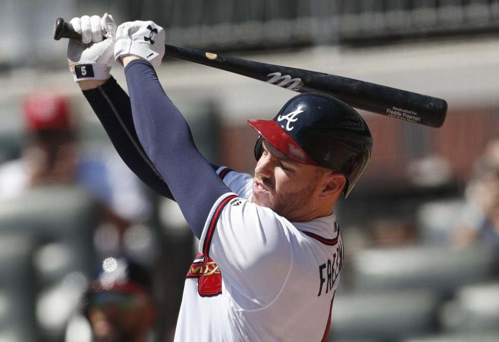 Atlanta's Freddie Freeman follows through for a two-run home run in the fourth inning of the Braves' 7-3 victory over the Cardinals on Wednesday in Atlanta. The Braves stopped a four game-losing streak and have a magic number of six to clinch the NL East.