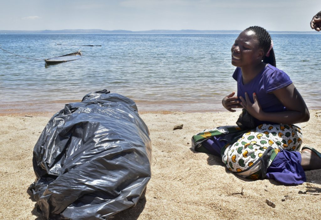 A woman cries beside the body of her sister, a victim of the MV Nyerere passenger ferry, as she awaits transportation for burial on Ukara Island, Tanzania, on Saturday. The death toll soared past 200 two days after the Lake Victoria disaster.
