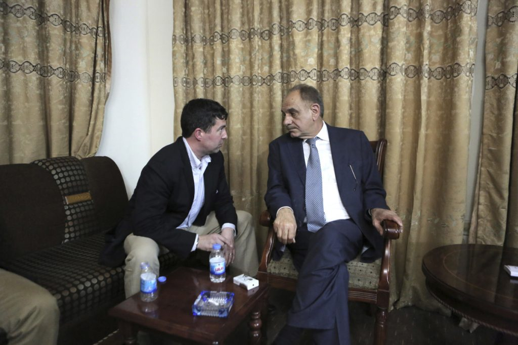 Sam Patten, left, speaks with Iraqi Deputy Prime Minister Saleh Mutlaq in Baghdad in April 2014. As Patten advised him in his bid to become prime minister that year, the Maine native had to protect himself with armored glass and security guards. Patten, 47, pleaded guilty last month to failing to register as a foreign agent related to his lobbying work in Ukraine. He also coordinated with a Russian national to help a Ukrainian citizen donate $50,000 to President Trump's inaugural committee.