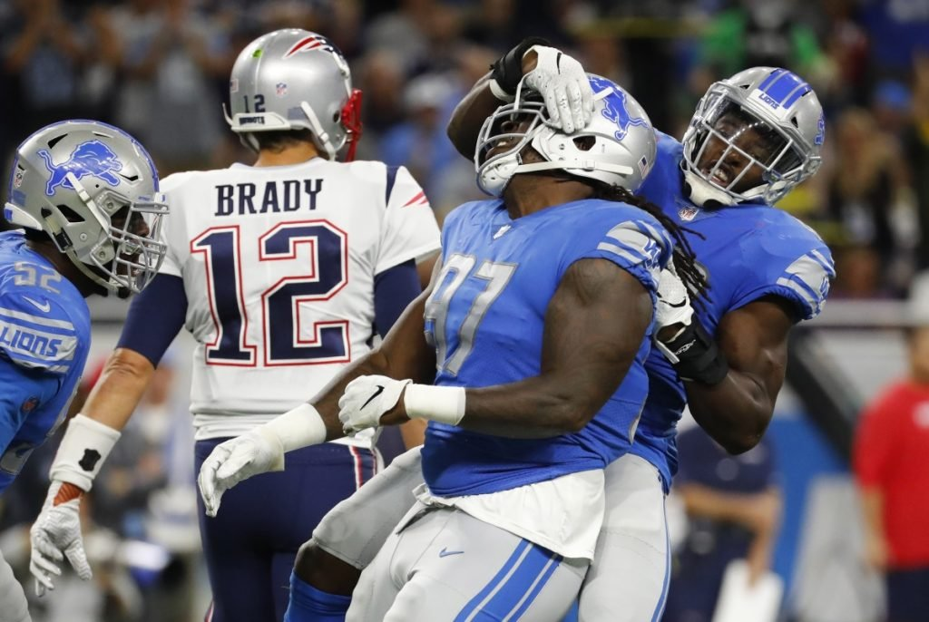 Detroit Lions linebacker Jarrad Davis, right, celebrates with defensive tackle Ricky Jean Francois, after a tackle during the first half of the Lions' 26-10 win over the Patriots on Sunday night in Detroit.