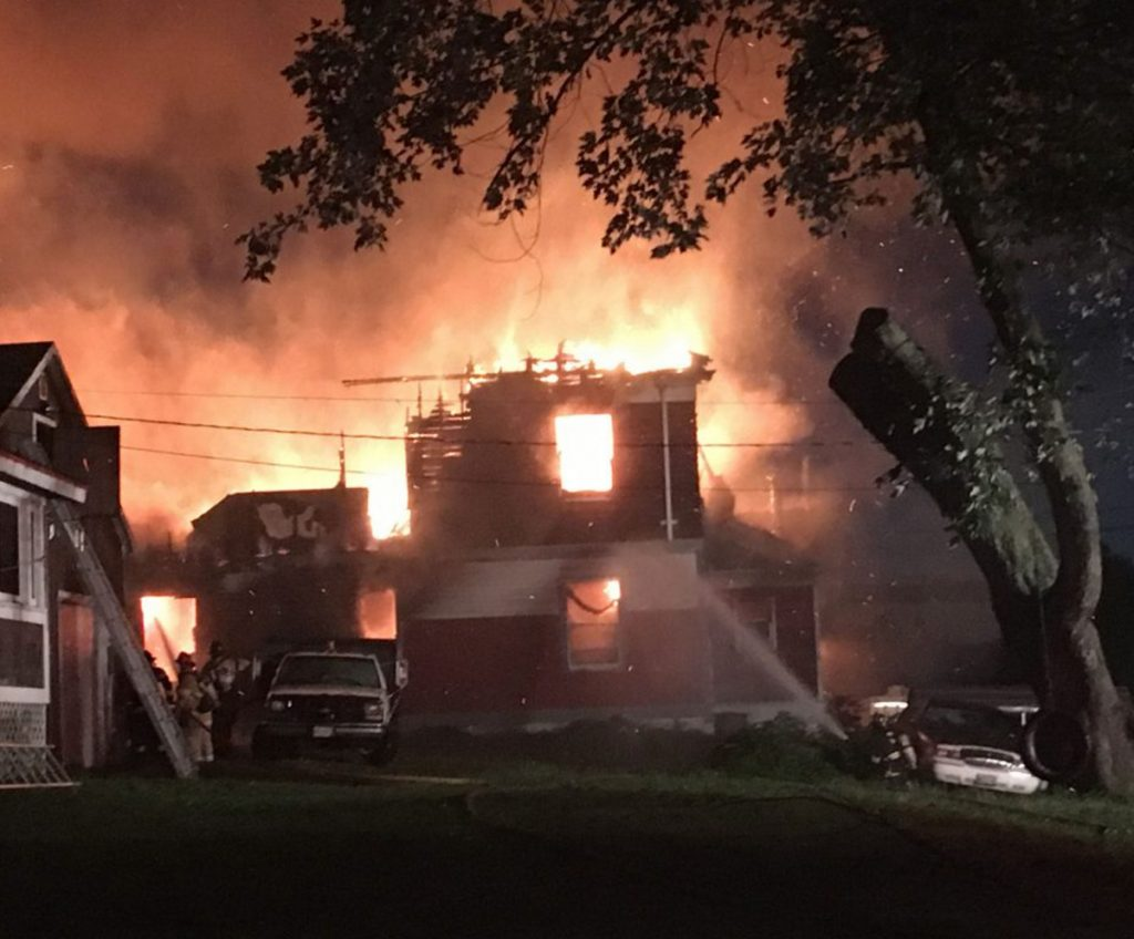 The former Sebenoa Hall was engulfed in flames when the first fire crew arrived on the scene Monday morning. The married couple living in the building escaped the blaze with their dog.