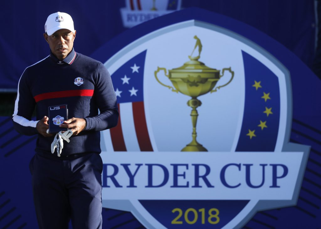 Tiger Woods of the US stands on the 1st tee before playing a shot in practice at Le Golf National in Guyancourt, outside Paris, France, Tuesday, Sept. 25, 2018. The 42nd Ryder Cup will be held in France from Sept. 28-30, 2018 at Le Golf National. (AP Photo/Alastair Grant)