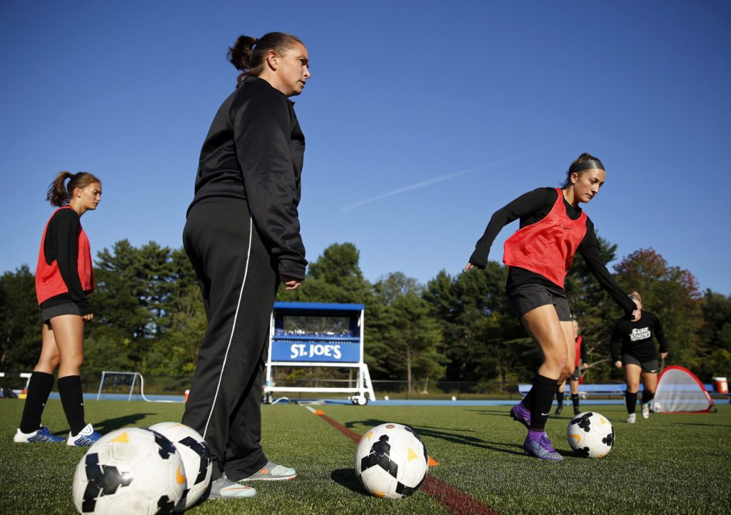 St. Joseph's women's soccer coach Jenelle Harris leads her team during a recent practice. The Monks are off to a 5-1 start and included 20 players who played high school soccer in Maine.
