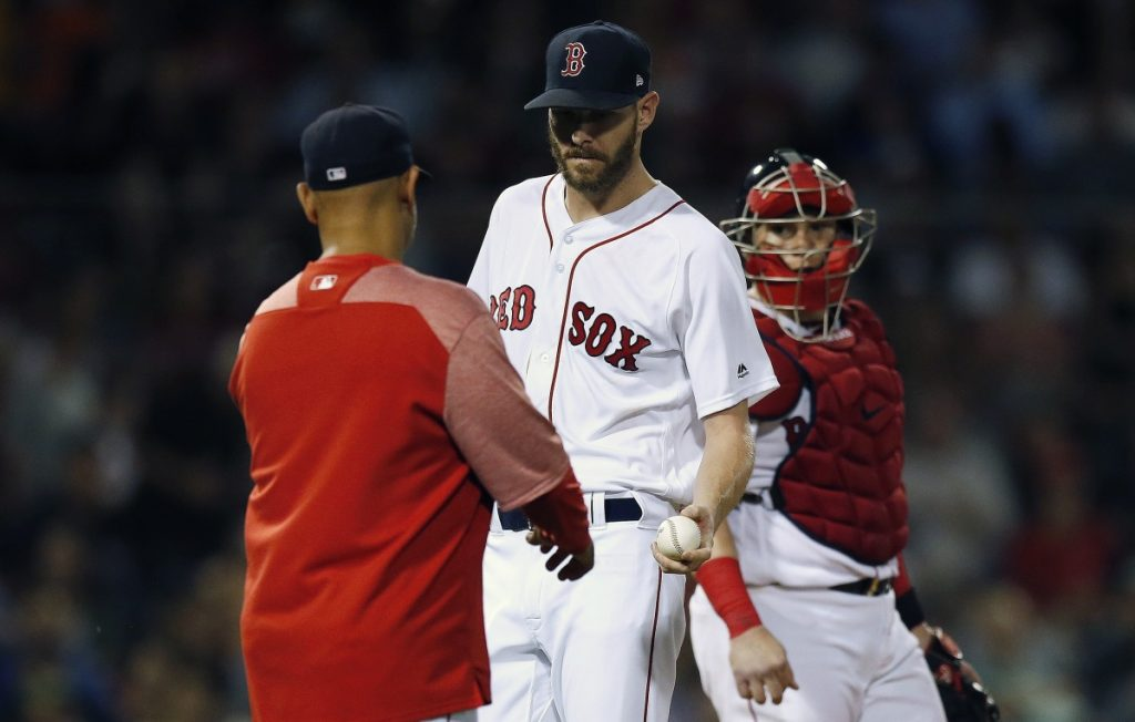 Boston Red Sox manager Alex Cora, left, relieves Chris Sale, center, during the fifth inning of the second game of a doubleheader against the Baltimore Orioles in Boston on Wednesday night. (AP Photo/Michael Dwyer)