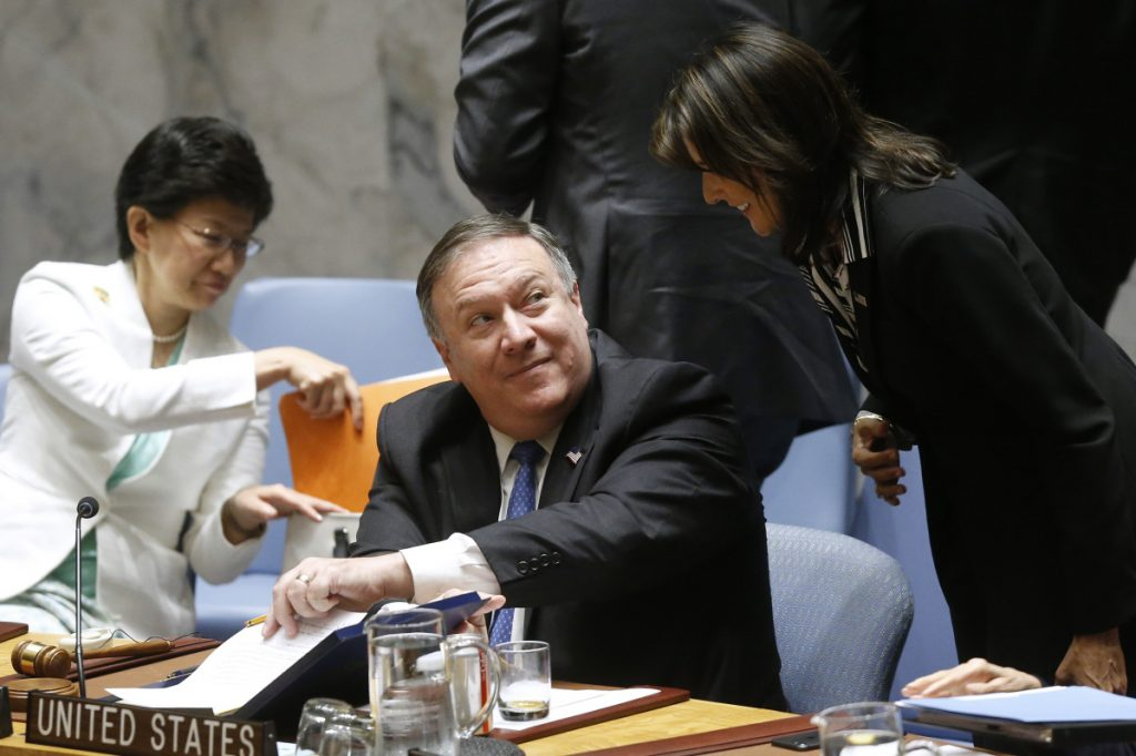 Secretary of State Mike Pompeo talks with Ambassador to the U.N. Nikki Haley at the U.N. on Thursday.