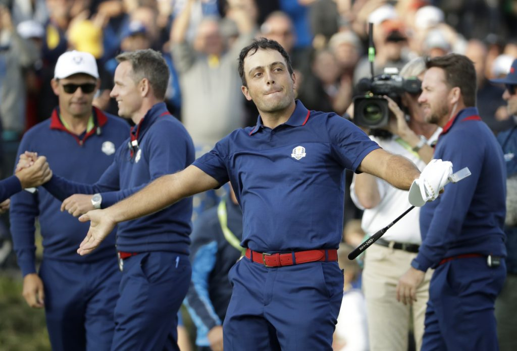 Europe's Francesco Molinari celebrates after winning a foursome match with his partner Tommy Fleetwood on the opening day of the Ryder Cup at Le Golf National in Saint-Quentin-en-Yvelines, France, on Friday. Molinari and Fleetwood beat Justin Thomas and Jordan Spieth of the U.S., 5 and 4. (AP Photo/Matt Dunham)