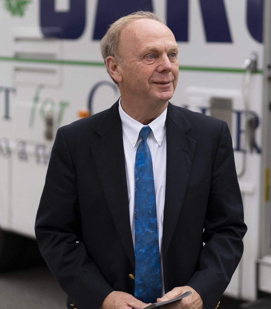 Independent gubernatorial candidate Alan Caron meets voters outside his campaign RV on a stop in Waterville.
