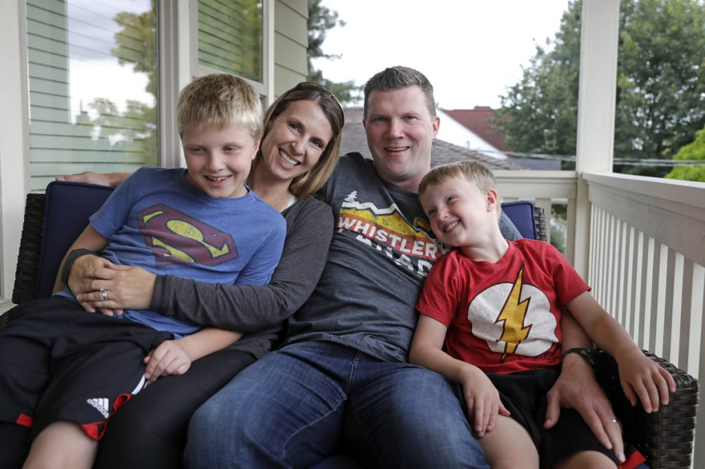 Tricia and Steve Schalekamp with their sons Evan, 9, left, and Alex, 6, in Seattle. The family paid at least $500 in nonrefundable waiting list fees for preschool for Evan.